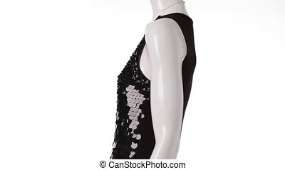 Mannequin in sequin dress turning. Black sequin dress with...