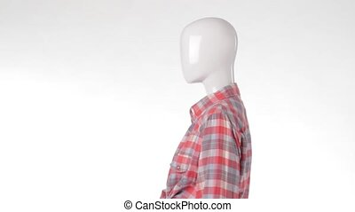 Mannequin in tied shirt rotating.
