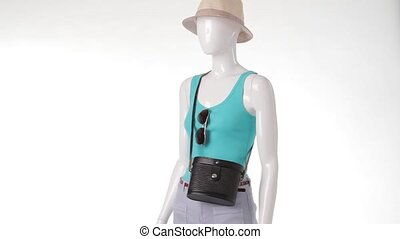 Mannequin in turquoise top rotating.