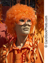 Mannequin man in orange halloween costume