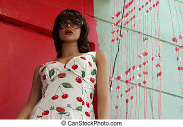 Mannequin wearing a dress and big sunglasses - fashion and...