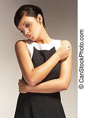 mannequin, posé, sur, lumière, fond, dans, robe noire