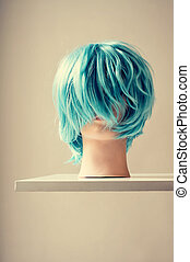 mannequin with a blue wig