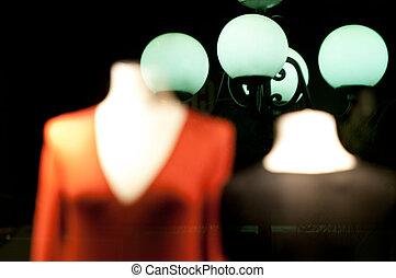 Mannequins in shop window.