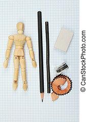Mannikin - Artists mannikin and drawing materials on graph ...