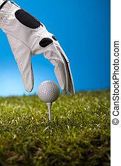 mano, asimiento, pelota de golf, con, tee