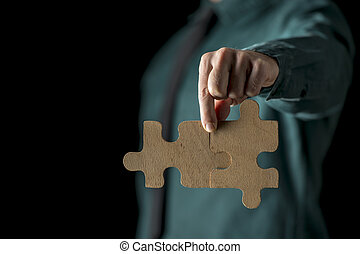 mano, con, due, confondere pezzi