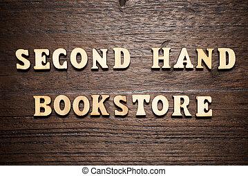 mano, libreria, secondo