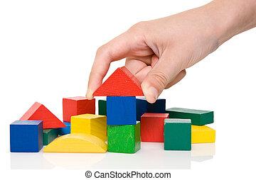 mano, marca, un, edificio, de, bloques de color