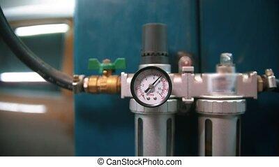 Manometer measuring pressure counter in the car repair shop. Mid shot