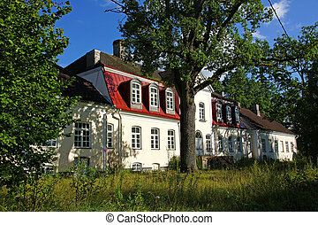 Manor behind trees - Old manor in the central Estonia. Purdi...