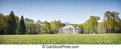 manor Eyckenstein and spring flowers near village of maartensdijk in the netherlands