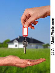 manos, con, llave, a, casa nueva