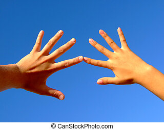 Man\\\'s and female hands on a background of the blue sky