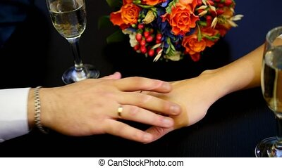 Man's and woman' hands on the table in cafe - Man's and...