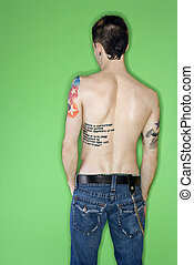 Man\'s back with tattoos.