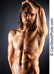 mans beauty - Sexual muscular nude man posing over dark...