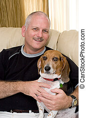 Mans Best Friend - a portrait of an attractive man and his...