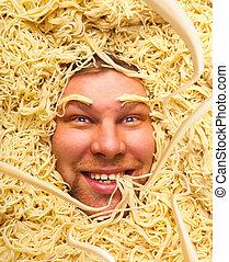 Man's face in pasta, closeup - Happy face of man in pasta