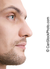 Man's face with blue eyes in a profile