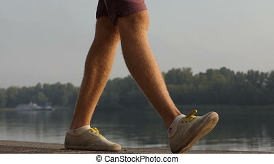 Man's Feet Walk Along The Dnipro Riverbank in Summer in Slo-Mo