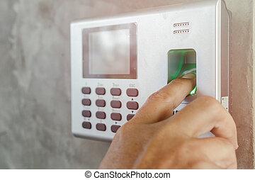 Man's finger over Finger print scan for enter security system