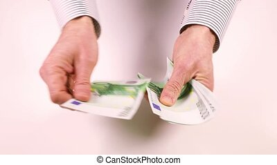 Man's hand counting money - Male hands take money off the...