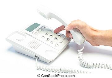 Man's hand dialing telephone keypad