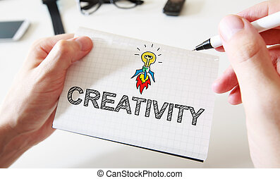 Mans hand drawing Creativity concept on notebook