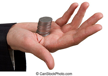 hand holding a stack of silver coins on white
