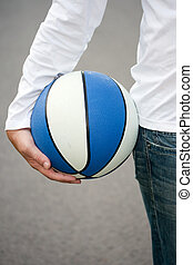 Mans hand holding basketball