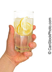 Man's hand holding glass of water with ice and lemon, isolated on white