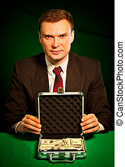 man's hand holds a suitcase with dollars