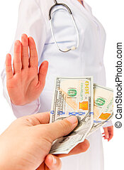 man's hand holds out bribe to doctor