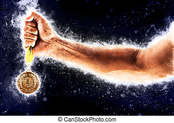 Man's hand in a blue fire is holding gold medal. Winner in a...