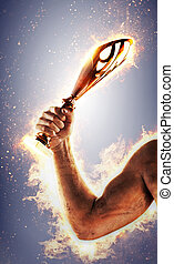 Man's hand in a fire is holding gold cup. Winner in a competition.
