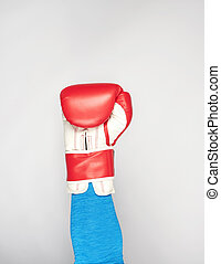 man's hand is wearing a red leather boxing glove