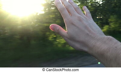 Man's hand over the car window
