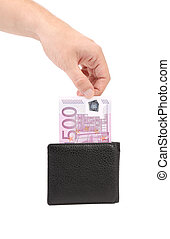 Man's hand pulling cash from the wallet.