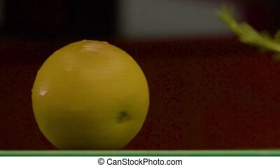 Man's Hand Rotate Ripe Delicious Yellow Lemon - Close - up -...