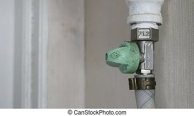 Man's hand to open and close the gas valve.