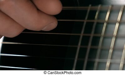 Man's hand touching strings. 4K macro video - Guitar...