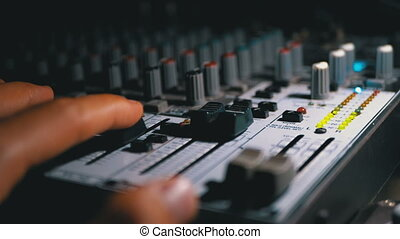 Man's hand Working with Sound Mixing Console. LED Signal...
