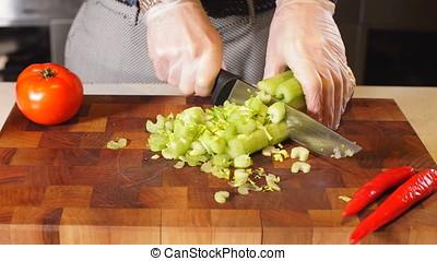 Man's hands cutting vegetables in restauran. - Man's hands...