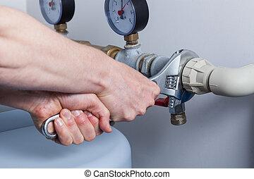 Man's hands during pipe repair