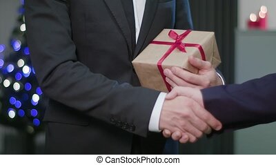 Man's Hands Giving a Christmas Gift
