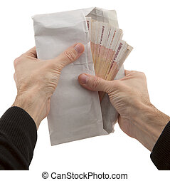 man's hands holding envelope with banknote