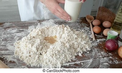 Man's hands knead the dough for home baking chef, pastry. ...