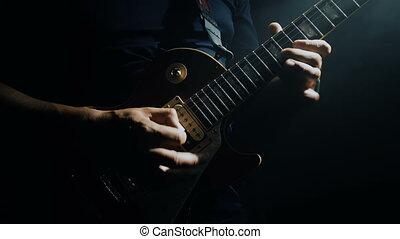 Man's hands playing electric guitar - Closeup of man's hands...