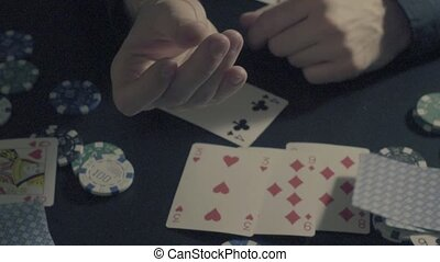 Man's hands showing tricks with playing cards